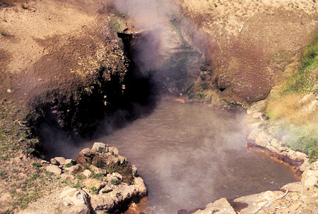 Dragon's Mouth Spring (it belches), Mud Volcano area, Yellowstone National Park
